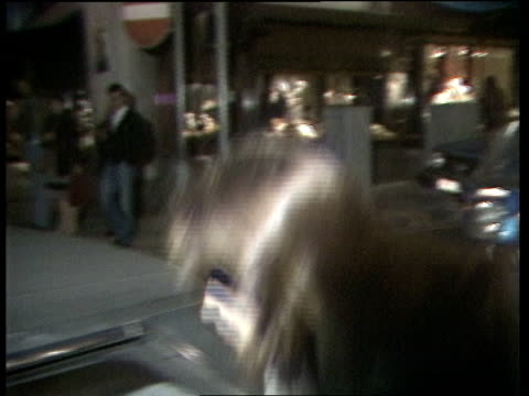 london piccadilly koo stark out of shop and into car and away to bv cas ex eng 18secs tx archive tape 20644 3521 to 3540 - koo stark stock-videos und b-roll-filmmaterial