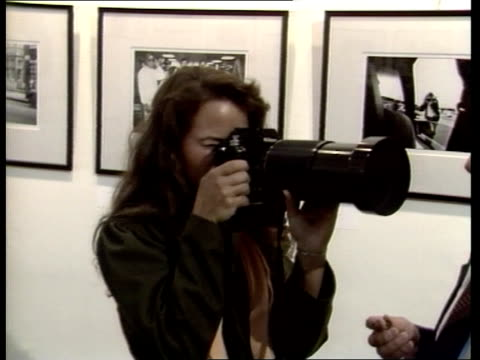 ms koo holding camera with zoom lens on it sof it's a very easy subject - koo stark stock-videos und b-roll-filmmaterial