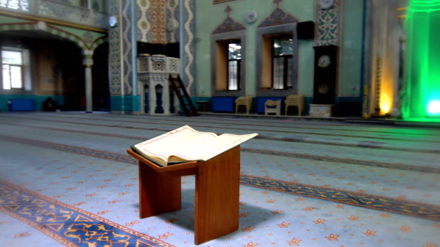 koran on lectern in mosque - islam stock videos & royalty-free footage