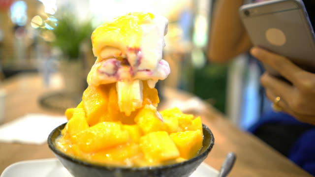 korea desert ( bingshu) mango served with sweetened - sweet food stock videos and b-roll footage