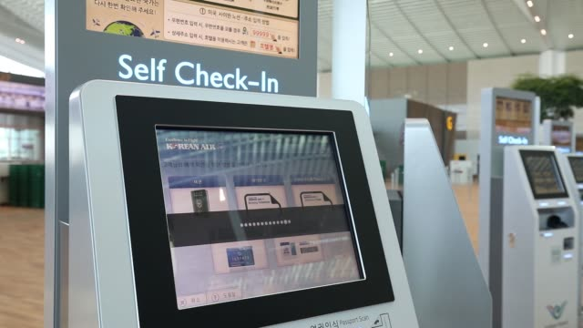 stockvideo's en b-roll-footage met a korean air lines co selfservice bagdrop counter is seen inside the nearly completed terminal 2 building during a media preview at incheon... - incheon