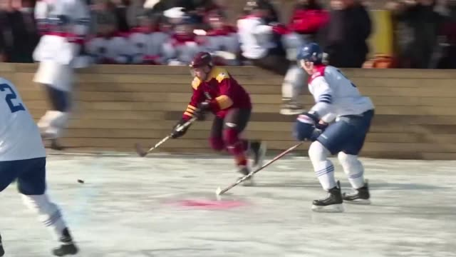 Korean and Canadian war veterans deliver the Olympic flame and take part in a friendly ice hockey game near the Demilitarized Zone separating North...
