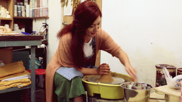 korean artist molding clay in her small studio shop - pottery stock videos & royalty-free footage