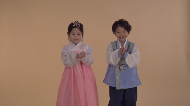 A Korean boy and a Korean girl wearing hanbok (Korean traditional attire)