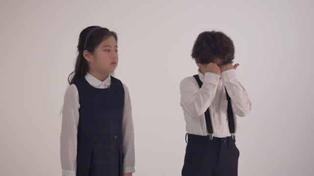a korean boy crying and a mad korean girl looking at him - schoolboy stock videos and b-roll footage