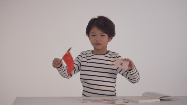 a korean boy holding a chinese flag - chinese script stock videos & royalty-free footage