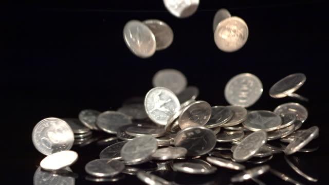 ms slo mo korean coins falling / seoul, south korea - coin stock videos & royalty-free footage