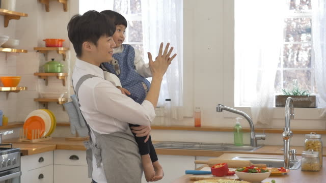 a korean dad and a korean girl at the kitchen - genderblend stock videos & royalty-free footage