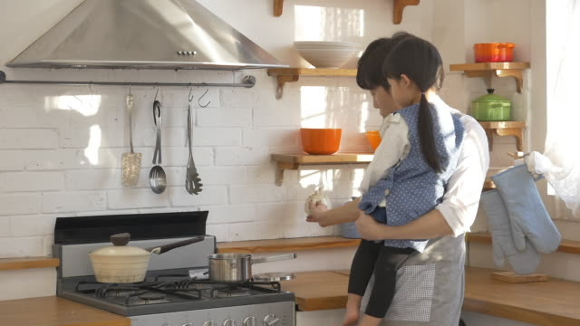 A Korean dad and a Korean girl at the kitchen