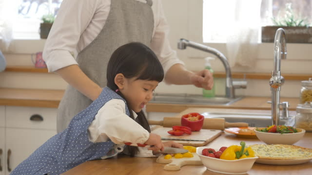 a korean dad and a korean girl cooking - genderblend stock videos & royalty-free footage