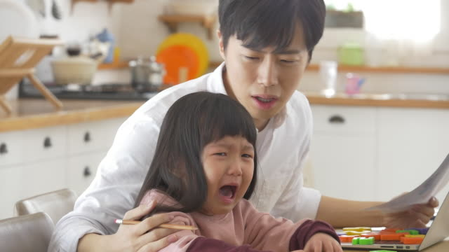 a korean dad contemplating while the daughter is crying - korean ethnicity stock videos & royalty-free footage