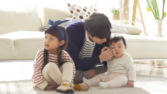 a korean dad with children in a bad mood - cushion stock videos and b-roll footage
