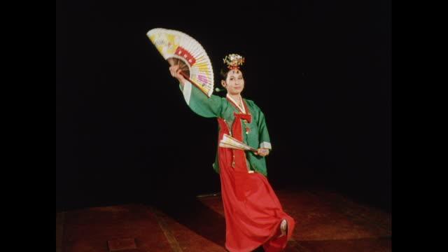 MONTAGE 1969 Korean fan dance on stage in London / United Kingdom