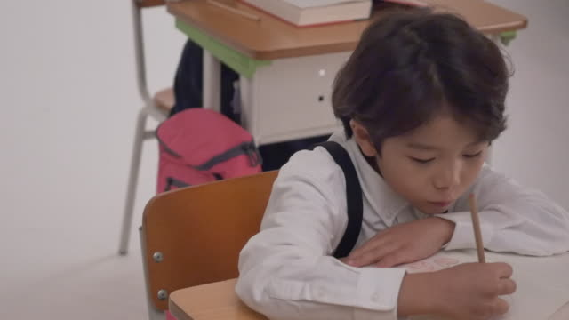 a korean girl and a korean boy studying at desks - korean ethnicity stock videos & royalty-free footage