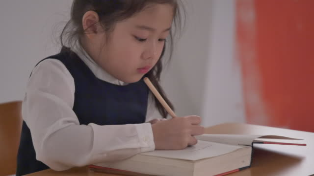 a korean girl studying at a desk - korean ethnicity stock videos & royalty-free footage