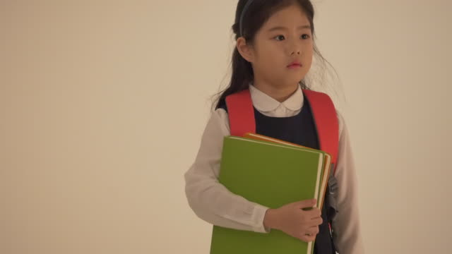 a korean girl wearing a backpack - one girl only stock videos & royalty-free footage