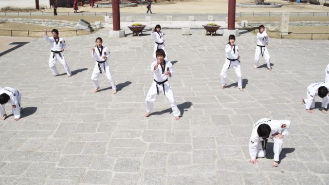 ws pan td korean martial arts group performing taekwondo  / kyungkido, bucheon, south korea - taekwondo stock videos & royalty-free footage