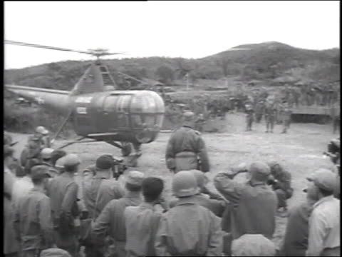 korean pilots in cockpit of helicopter / helicopter taking off and flying away - 1951 stock videos & royalty-free footage