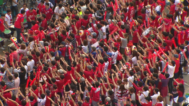 korean soccer fans cheering for national soccer team at gwanghwamun square - south korea stock videos & royalty-free footage