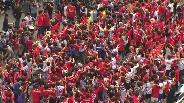 Korean soccer fans cheering for national soccer team at Gwanghwamun Square