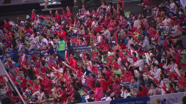 korean soccer fans cheering for national soccer team at yeongdongdaero(main street of the gangnam) - national team stock videos & royalty-free footage