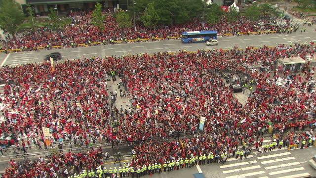 korean soccer fans jump with joy because of national soccer team at gwanghwamun square - urban road stock videos & royalty-free footage