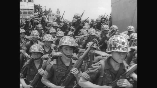 korean troops depart from landing craft to aid america in vietnam / general westmoreland and major general kai welcome the troops / troops get into... - indocina video stock e b–roll