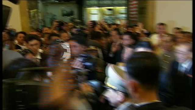 korean war 60th anniversary celebrations continue t27071311 / tx kim jongun along surrounded by others at museum as reporter heard asking 'kim jongun... - surrounding stock videos and b-roll footage