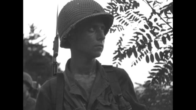 vidéos et rushes de cu american soldier drinking from canteen / cu american soldier / ls platoon waiting / bombs exploding / airmen loading truck during evacuation of... - actualités cinématographiques