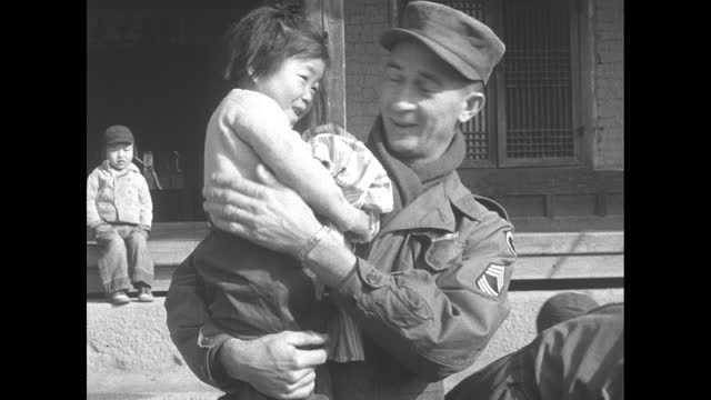 korean war / sign do-bong orphan asylum / children running up to american soldiers on korean new year / boxes of clothes for orphans to celebrate the... - capodanno coreano video stock e b–roll