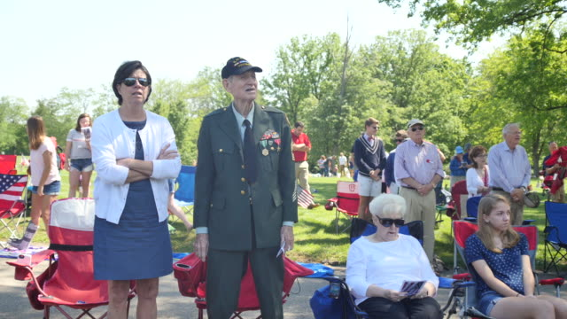 a korean war veteran sings back home in indiana during memorial day ceremonies at valhalla memory gardens may 29 2017 in bloomington ind a new war... - veterans of foreign wars of the united states stock videos & royalty-free footage