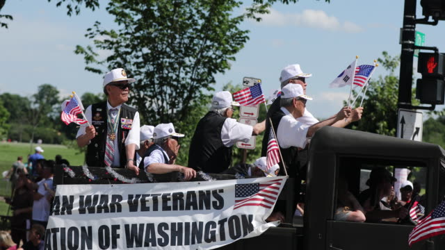 korean war veterans ride on a float during the national memorial day parade on memorial day - parade float stock videos and b-roll footage