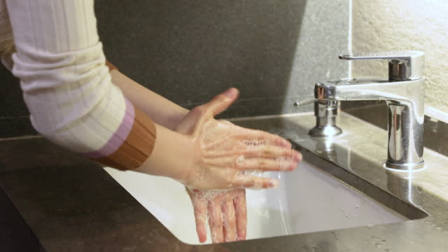 a korean woman in her 30s washing hands in toilet - stationary process plate stock videos & royalty-free footage