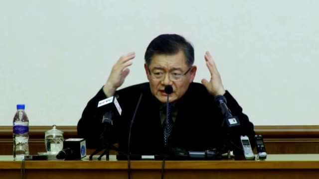 """korean-canadian pastor detained in north korea since january confessed to """"subversive plots"""" against the communist state during a news conference in... - 懺悔点の映像素材/bロール"""