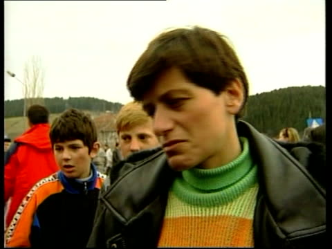 Albanian Refugee Crisis ITN MONTENEGRO Rozaje Tractor and trailer carrying ethnic Albanian refugees along mountain road as V/O woman refugee SOT The...