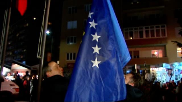 kosovo celebrates declared independence from serbia kosovo pristina two albanian men as raise blue republic of kosovo flag on flagpole sot / crowd of... - pristina stock videos and b-roll footage