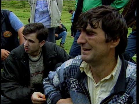 refugees / war crimes ann mark austin albania border with kosovo i/c day gv kosovar albanian refugee men released by serb forces towards in line... - serbia stock videos & royalty-free footage