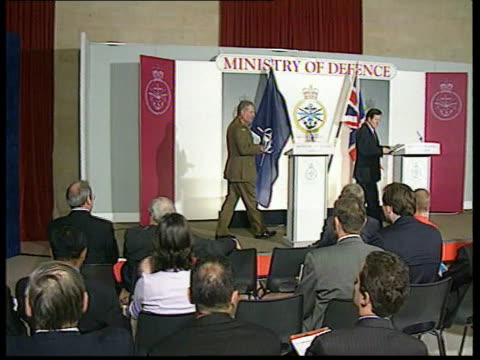 refugees / war crimes mod england london ministry of defence int george robertson mp along on stage and press conference sot some people still... - イギリス国防省点の映像素材/bロール