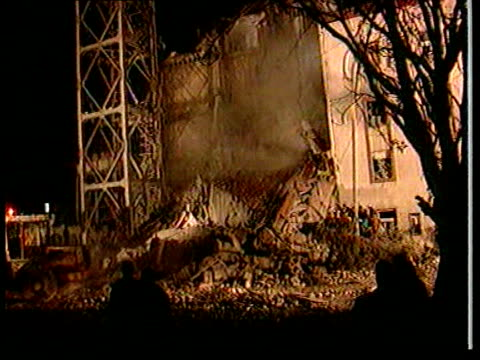 yugoslav tv station bombed ann julian yugoslavia serbia belgrade night bombed building with smoke rising as jcb drives along with flashing lights... - kosovo stock videos & royalty-free footage