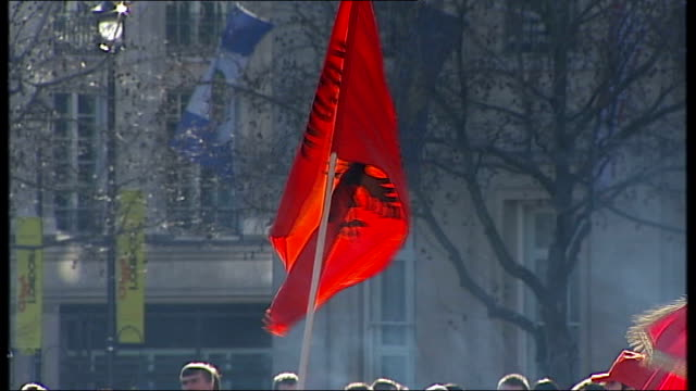 Kosovo declares independence from Serbia ENGLAND London Shaftesbury Avenue EXT Line of cars along displaying red Kosovo flags and sounding horns SOT...