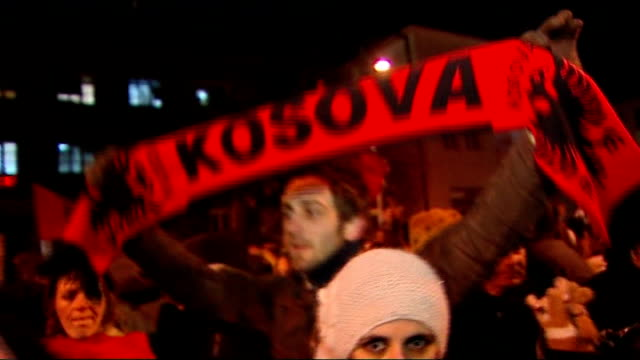 kosovo declares independence from serbia kosovo pristina ext / night **music heard sot** people celebrating the independence of kosovo in the street... - pristina stock videos and b-roll footage
