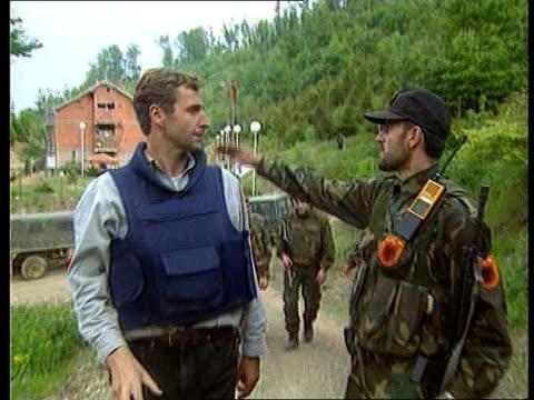 Kosovo TGV KLA Army barracks before NATO attack Mark Austin along with KLA soldiers KLA Troops standing on hillside GVs exBritish serviceman training...
