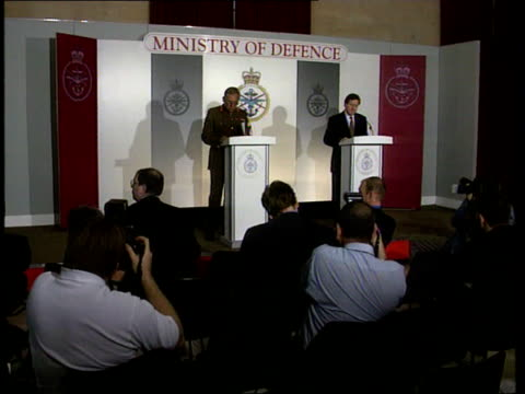 nato attacks day four england london ministry of defence int george robertson mp and general sir charles guthrie at podiums for press conference... - イギリス国防省点の映像素材/bロール