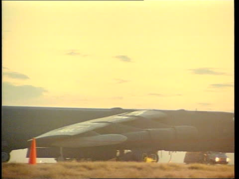 nato attacks day four m1645 kevin england gloucestershire raf fairford b52 bomber silhouetted against the setting sun ms cruise missile on trolley... - raf fairford stock videos and b-roll footage