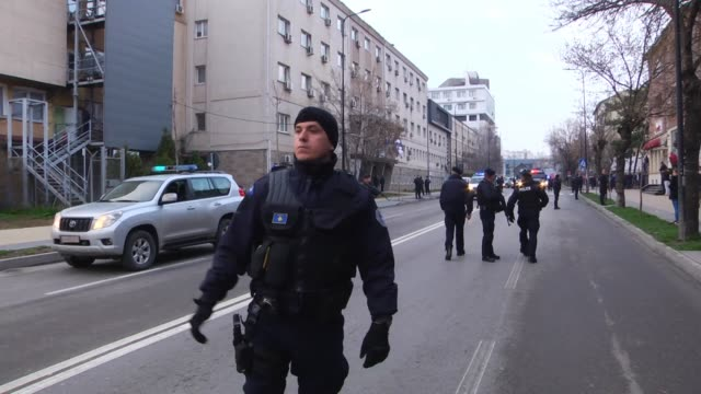 kosovo police escort marko djuric a serb official to a police station in kosovo capital pristina after he was arrested in northern kosovo town of... - 後を追う点の映像素材/bロール