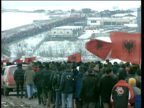 kosovo pristina gvs protesters marching from pristina to mitrovica for unity of city ms kfor jeep along in front of marchers bv marchers away along... - pristina stock videos and b-roll footage