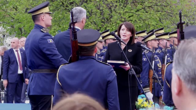 Kosovo's newly elected President Hashim Thaci receives the Kosovo constitution from outgoing President Atifete Jahjaga reviews the guard of honor...