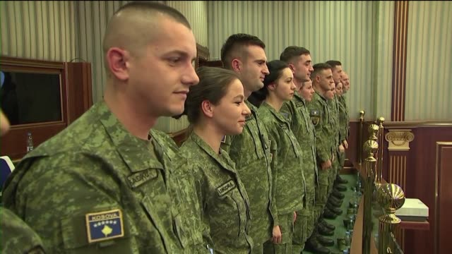 stockvideo's en b-roll-footage met kosovo's parliament passes laws to build an army asserting its statehood in a move that has angered serbia who does not recognise the former... - kosovo