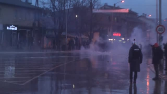 kosovo's security forces block a street near the parliament building as they clash with the opposition supporters in pristina kosovo on february 26... - 対決点の映像素材/bロール