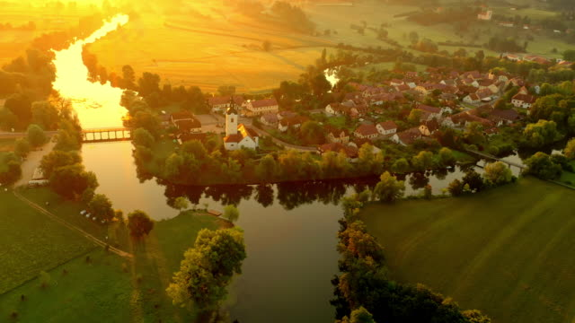stockvideo's en b-roll-footage met aerial kostanjevica na krki at sunset - aircraft point of view